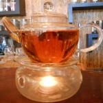 a glass pot of tea on a warmer